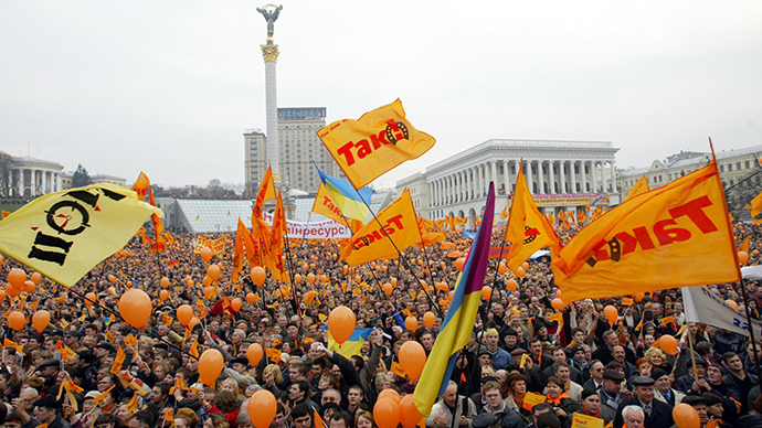 Flags of the opposition wave  during a pre-election rally of Yushchenko supporters at Independence square in Kiev 06 November, 2004. (AFP Photo / Sergey Supinsky)