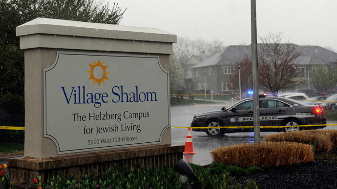A police car blocks the scene of a shooting at Village Shalom, an assisted living center, as rain falls in Overland Park, Kansas April 13, 2014. (Reuters / Dave Kaup)