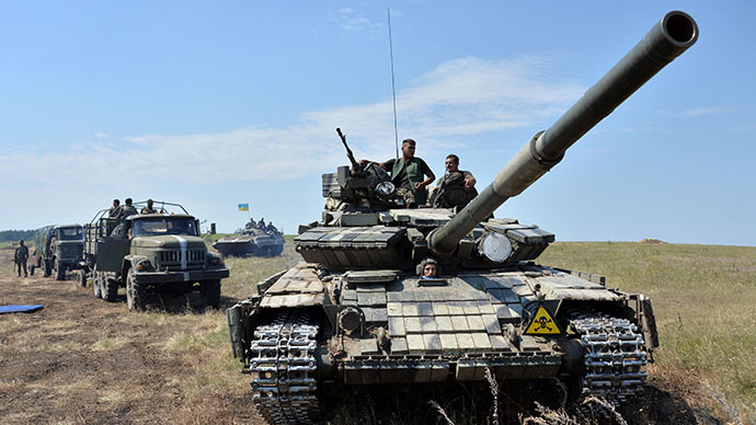 A convoy of military vehicles of the Ukrainian forces drives towards the eastern Ukrainian city of Lysychansk, in the region of Lugansk, on July 25, 2014. (AFP Photo / Genya Savilov)