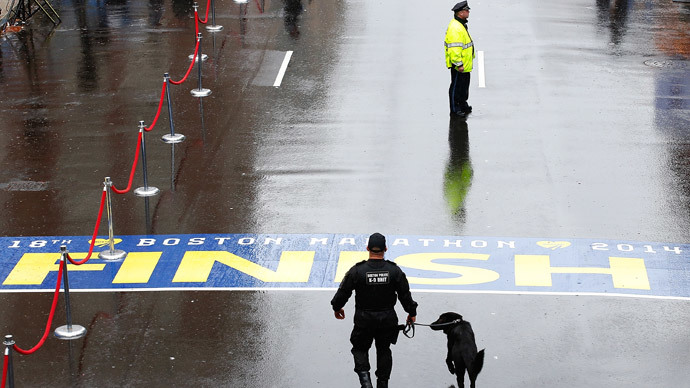 Boston Police officers and a K-9 unit patrol the finish line of the Boston Marathon.(AFP Photo /  Jared Wickerham)