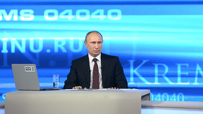 "President Vladimir Putin seen on his annual ""Direct Line with Vladimir Putin"" call-in live broadcast by Channels One, Rossiya-1 and Rossiya-24 as well as Mayak, Vesti FM and Radio Rossii radio stations, April 17, 2014 (RIA Novosti / Alexey Nikolsky)"