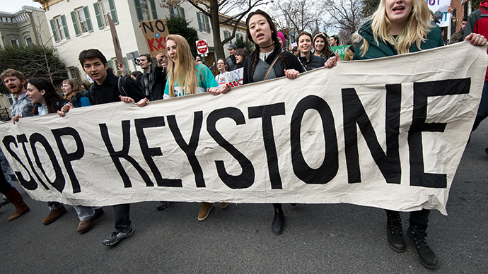 Students protesting against the proposed Keystone XL pipeline march to the residence of US Secretary of State John Kerry in Washington,DC on March 2, 2014 before going on to the White House. (AFP Photo / Nicholas Kamm)