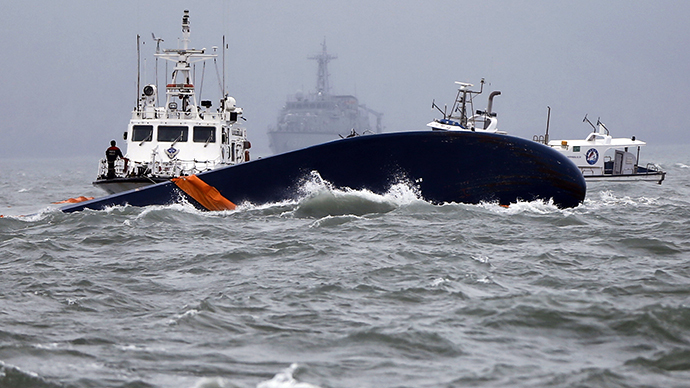 Vessels involved in salvage operations are seen near the upturned South Korean Sewol ferry in the sea off Jindo April 17, 2014 (Reuters / Issei Kato)