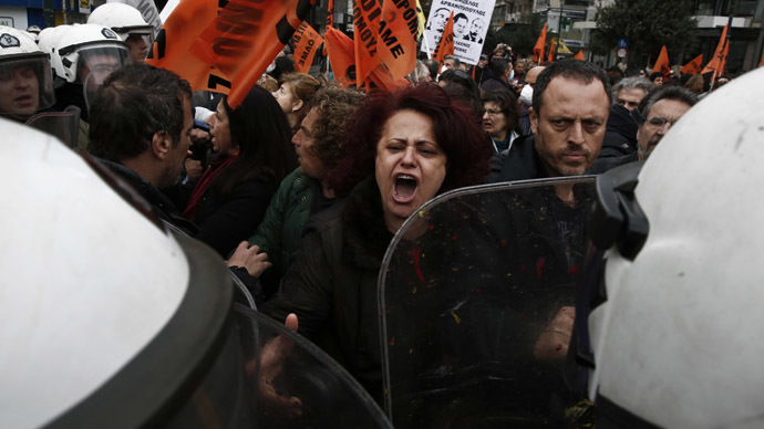 Protesters from the public sector scuffle with police during an anti-austerity rally outside the Finance Ministry in Athens February 28, 2014. (Reuters/Yorgos Karahalis)