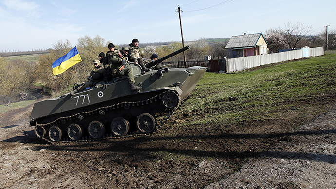 Ukrainian soldiers drive an airborne combat vehicle near Kramatorsk, in eastern Ukraine April 16, 2014. (Reuters / Marko Djurica)