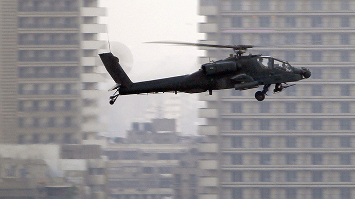 An Apache helicopter flies over Tahrir Square during a protest to support the army, in Cairo (Reuters / Amr Dalsh)