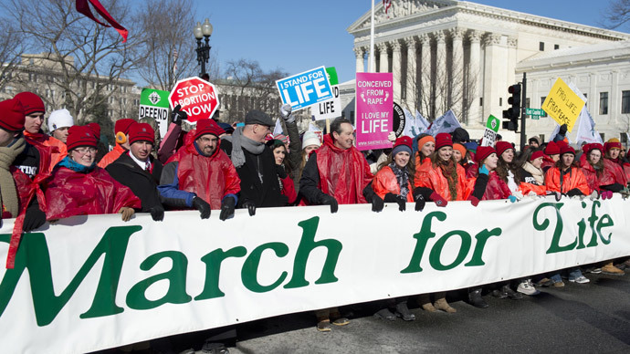 Anti-abortion demonstrators protest as they walk past the US Supreme Court.(AFP Photo / Saul Loeb )