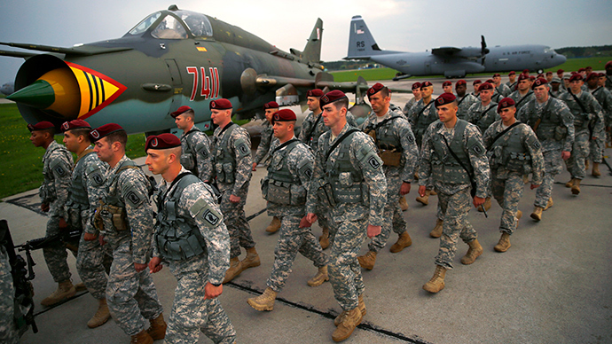 First company-sized contingent of about 150 U.S. paratroopers from the U.S. Army's 173rd Infantry Brigade Combat Team based in Italy march as they arrive to participate in training exercises with the Polish army in Swidwin, northern west Poland April 23, 2014 (Reuters / Kacper Pempel)