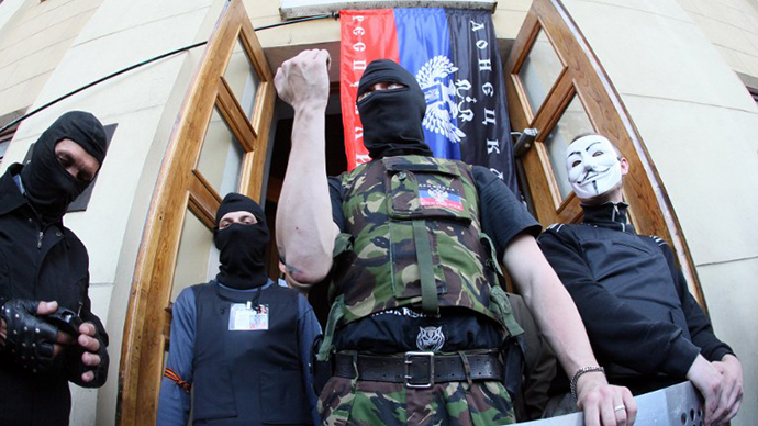 Activists stand guard outside a regional television station after it was seized by pro-Russian separatists, in the eastern Ukrainian city of Donetsk, on April 27, 2014. (AFP Photo / Alexander Khudoteply)