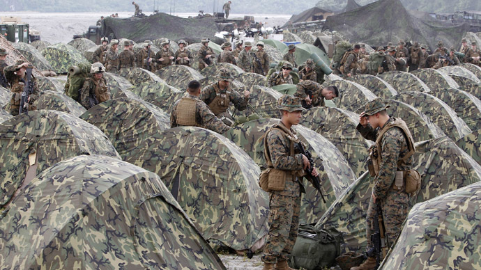 U.S marines look for their tents as they arrive at Crow Valley for the Philippines-U.S. amphibious landing exercise dubbed Phiblex 2013 in Tarlac, north of Manila, October 9, 2012. (Reuters)