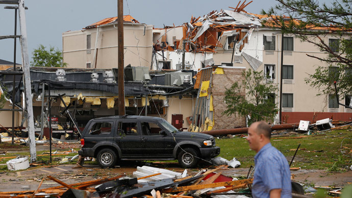 A man walks by the Steak Escape and Sleep Inn along North Gloster Street after a tornado went through Tupelo, Mississippi April 28, 2014. (Reuters / Lauren Wood)
