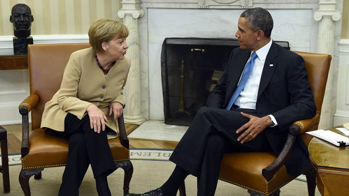 US President Barack Obama and German Chancellor Angela Merkel talk before a bilateral meeting in the Oval Office at the White House on May 2, 2014 in Washington, DC (AFP Photo / Jewel Samad)