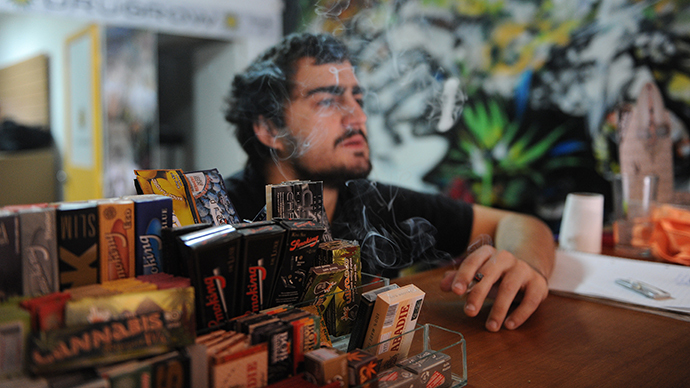Juan Manuel, owner of the first shop dedicated to cannabis merchandising in Montevideo, smokes a joint on April 24, 2014. (AFP Photo / Miguel Rojo)