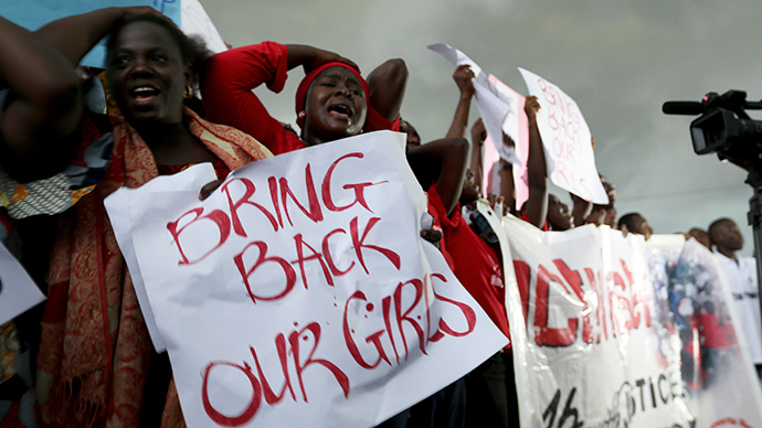 Women react during a protest demanding security forces search harder for 200 schoolgirls abducted by Islamist militants two weeks ago, outside Nigeria's parliament in Abuja April 30, 2014 (Reuters / Afolabi Sotunde)