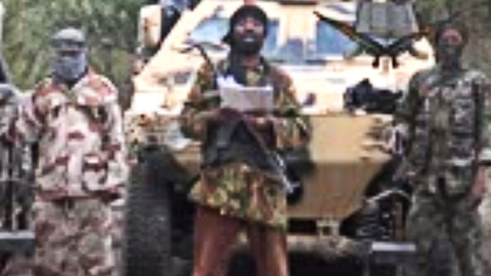 A grab made on May 5, 2014 from a video obtained by AFP shows the leader of the Islamist extremist group Boko Haram Abubakar Shekau (C) delivering a speech. (AFP Photo)