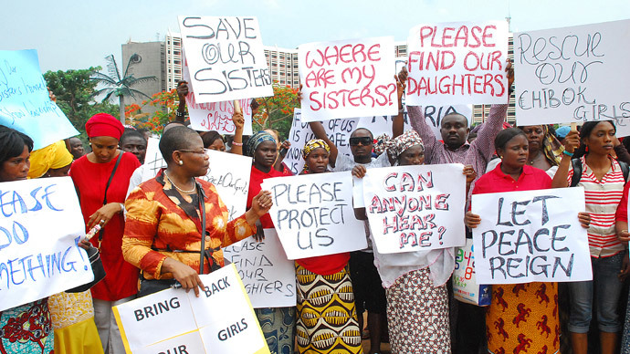 Former Nigerian Education Minister and Vice-President of the World Bank's Africa division (3rd L) Obiageli Ezekwesilieze speaks as she leads a march of Nigeria women and mothers of the kidnapped girls of Chibok, calling for their freedom in Abuja on April 30, 2014.(AFP Photo / Philip Ojisua )