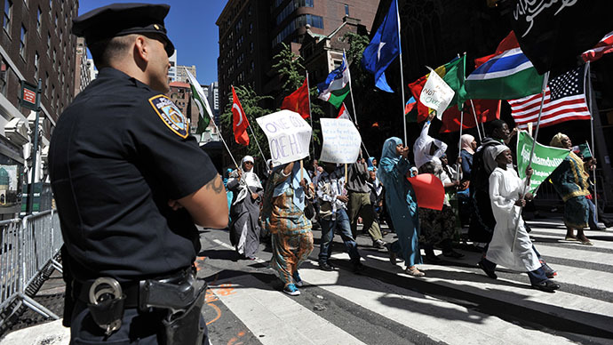 A New York City Police Department officer watches the 27th annual Muslim Day Parade in New York. (AFP Photo / Stan Honda)