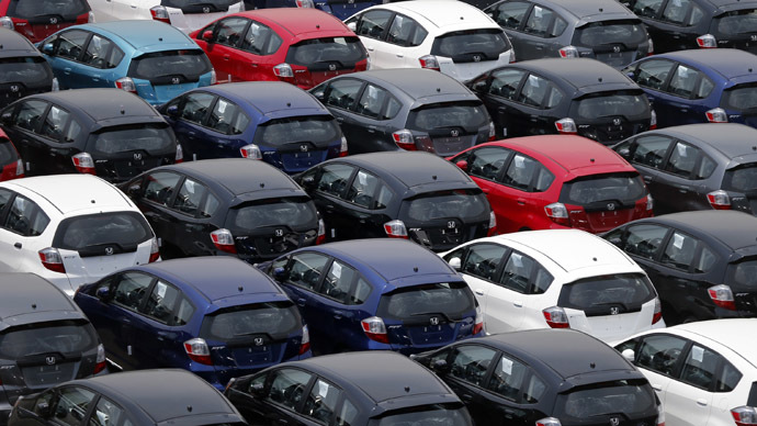 Newly produced Honda Motor cars are seen at an industrial port before they are loaded to a cargo ship in Yokohama, south of Tokyo May 17, 2012. (Reuters/Kim Kyung-Hoon)