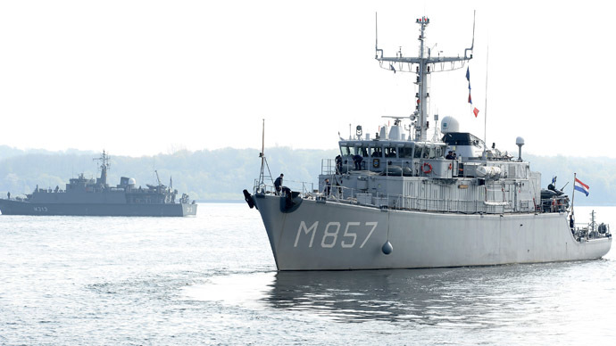 "Dutch mine hunter ""Makkum"" (R), departs as part of the Standing NATO Mine Counter-Measures Group ONE (SNMGMG1) in the harbour of Kiel, April 22, 2014. (Reuters/Fabian Bimmer)"
