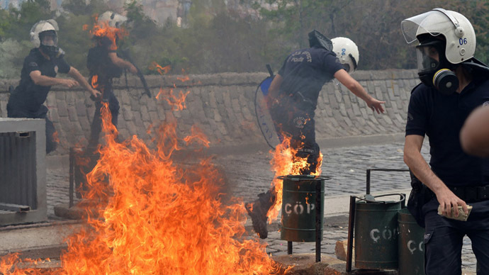Riot police run away from the flames of a fire bomb thrown by protesters as they demonstrate to blame the ruling AK Party (AKP) government on the mining disaster in western Turkey, in Ankara May 14, 2014. (Reuters)
