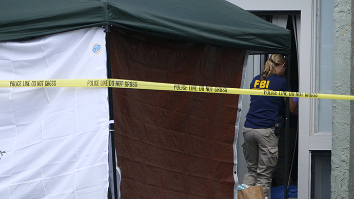 A member of the FBI enters the apartment of Ibragim Todashev, 27, in Orlando, Florida, May 22, 2013. (Reuters / Phelan Ebenehack)