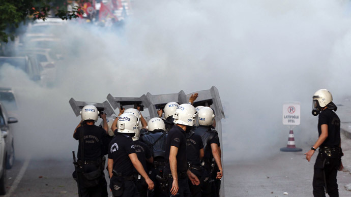 Turkish riot police use tear gas against protesters in Ankara on May 14, 2014.(AFP Photo / Adem Altan )
