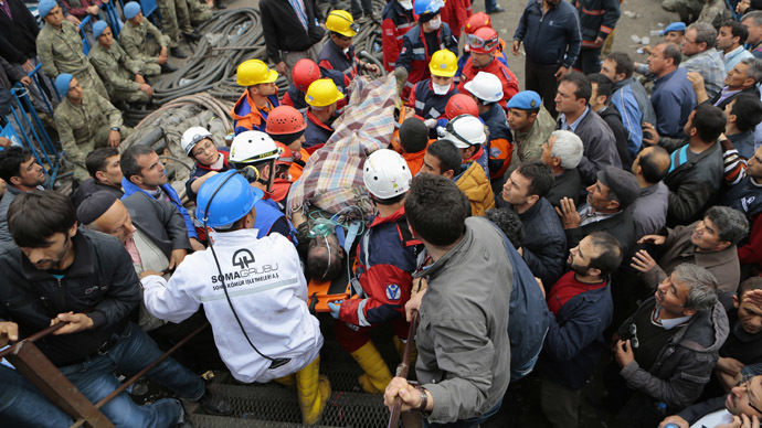 An injured miner is carried to an ambulance after being rescued from a coal mine he was trapped in Soma, a district in Turkey's western province of Manisa May 14, 2014. (Reuters/Yasin Akgul/Depo Photos)