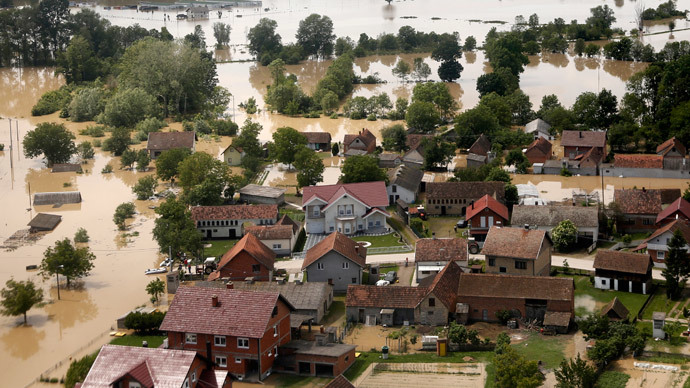 An aerial view of the flooded city of Orasje May 18, 2014. Russian cargo planes and rescue teams from around Europe on Sunday joined huge volunteer aid efforts in swathes of Serbia and Bosnia where at least 24 people have died in the worst floods in over a century.(Reuters / Dado Ruvic)