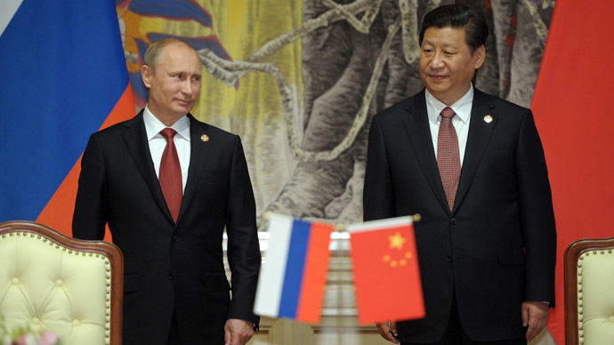 May 21, 2014. President Vladimir Putin, left, and Chinese leader Xi Jinping during the signing of joint agreements in Shanghai. (RIA Novosti/Alexei Druzhinin)