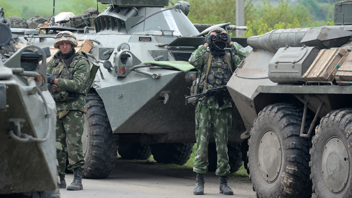 Ukrainian troops outside the town of Andreyevskoe near Slaviyansk, Donetsk Region, where local residents blocked a column of Ukrainian Army armored personnel carriers (RIA Novosti / Mikhail Voskresenskiy)