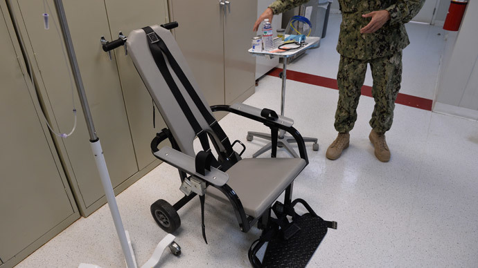 "This photo reviewed by the US military and made during an escorted visit shows a US naval medic explaining the ""feeding chair"" procedures at the detention facility in Guantanamo Bay, Cuba, April 9, 2014.(AFP Photo / Mladen Antonov )"