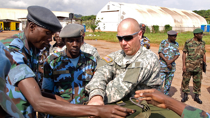 ARCHIVE PHOTO: US soldiers assist Ugandan Airforce personnel as they package food supplies at a military airbase in Entebbbe, Uganda on December 6, 2011 (AFP Photo / Michele Sibiloni)