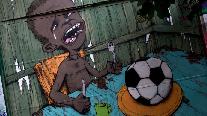 A graffiti painted by Brazilian street artist Paulo Ito on the entrance of a public schoolhouse in Sao Paulo, Brazil on May 23, 2014. (AFP Photo / Nelson Almeida)