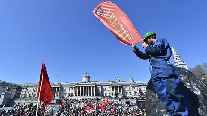 A protester holds a placard during a rally in Trafalgar Square in central London May 1, 2013. (Reuters / Toby Melville)