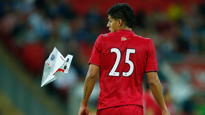 Peru's Hansell Riojas reacts after being hit by a paper airplane thrown from the crowd during their international friendly soccer match against England at Wembley Stadium in London May 30, 2014.(Reuters / Eddie Keogh)