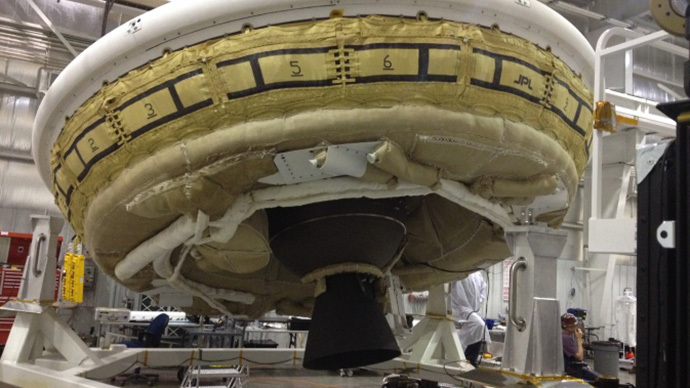 A saucer-shaped test vehicle holding equipment for landing large payloads on Mars is shown in the Missile Assembly Building at the US Navy's Pacific Missile Range Facility in Kaua'i, Hawaii.  (Image Credit: NASA / JPL-Caltech)