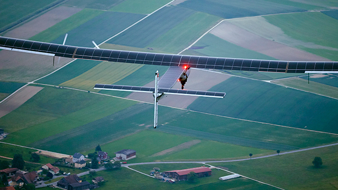 German test pilot Markus Scherdel steers the solar-powered Solar Impulse 2 aircraft for its maiden flight at its base in Payerne on June 2, 2014 (AFP Photo / Denis Balibouse)