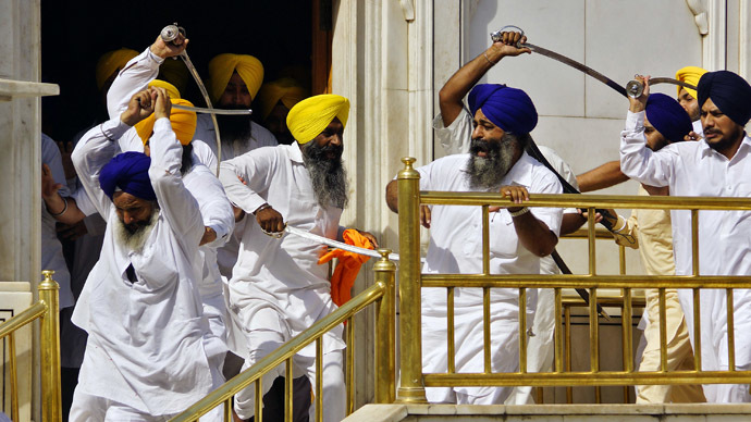 Sikhs wield swords during their clash inside the complex of the holy Sikh shrine, the Golden Temple, in the northern Indian city of Amritsar June 6, 2014. (Reuters/Munish Sharma)