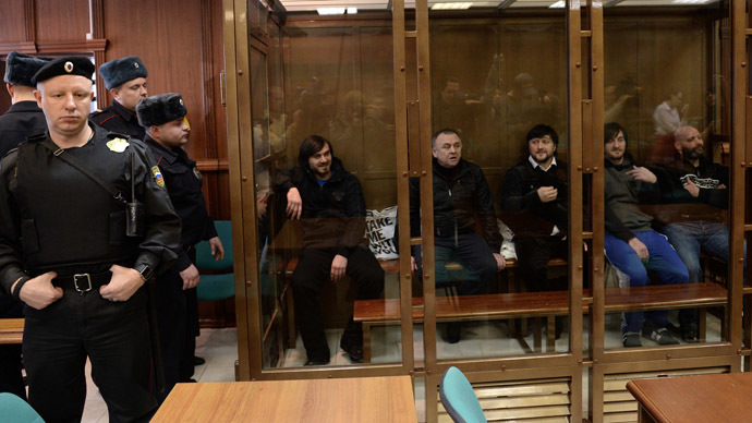 From left: Dzhabrail Makhmudov, Lom-Ali Gaitukayev, Rustam Makhmudov, Ibragim Makhmudov and Sergei Khadzhikurbanov, defendants in Novaya Gazeta columnist Anna Politkovskaya murder case, during a hearing in the Moscow City Court. (RIA Novosti/Alexey Filippov)