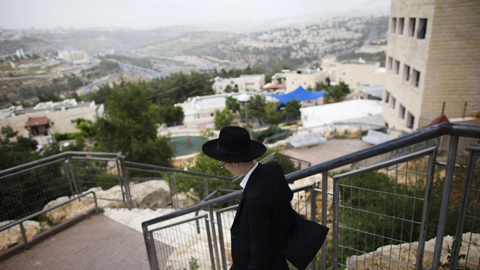 An ultra-Orthodox Jew walks in Ramat Shlomo, a religious Jewish settlement in an area of the occupied West Bank Israel annexed to Jerusalem, June 5, 2014. (Reuters/Ronen Zvulun)
