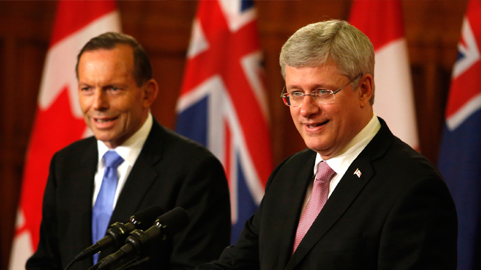 Canada's Prime Minister Stephen Harper (R) and his Australian counterpart Tony Abbott hold a joint news conference after a meeting on Parliament Hill in Ottawa June 9, 2014 (Reuters / Patrick Doyle)