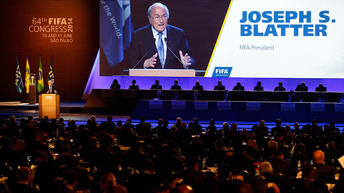 FIFA President Sepp Blatter is seen on a big screen as he delivers a speech during the opening ceremony of the 65th FIFA Congress in Sao Paulo June 11, 2014. (Reuters / Paulo Whitaker)