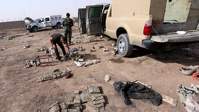 Iraqi military kit litters the ground close to the Kukjali Iraqi Army checkpoint, some 10km of east of the northern city of Mosul, on June 11, 2014, the day after Sunni militants, including fighters from the Islamic State of Iraq and the Levant (ISIL) overran the city. (AFP Photo / Safin Hamed)
