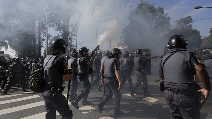 Riot policemen fire tear gas at demontrators during a protest against the 2014 World Cup in Sao Paulo June 12, 2014. (Reuters / Ricardo Moraes)