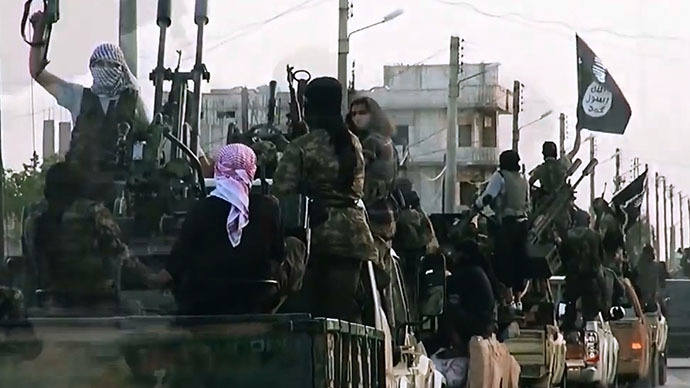 An image grab taken from a propaganda video released on March 17, 2014 by the Islamic State of Iraq and the Levant (ISIL)'s al-Furqan Media allegedly shows ISIL fighters driving on a street in the northern Syrian City of Homs. (AFP Photo)
