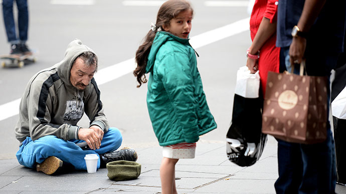 A homeless man sittiing on a street in Sydney. (AFP Photo / Peter Parks)