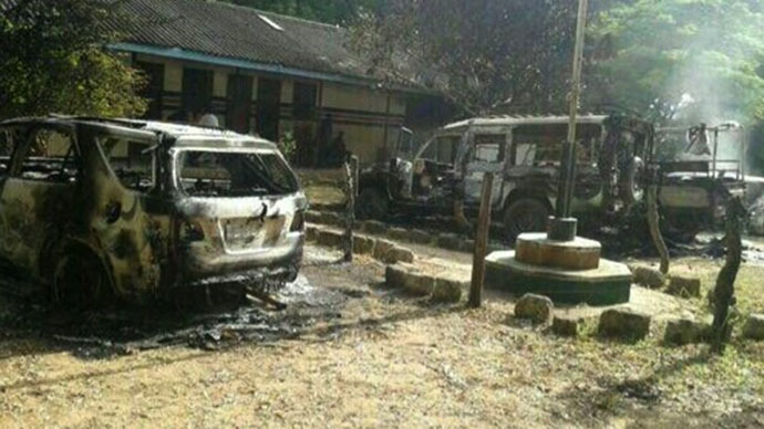 Vehicles burned out following the June 15-16, 2014 assault on the Kenyan coastal town of Mpeketoni, which left 48 people dead. Image from trending.co.ke