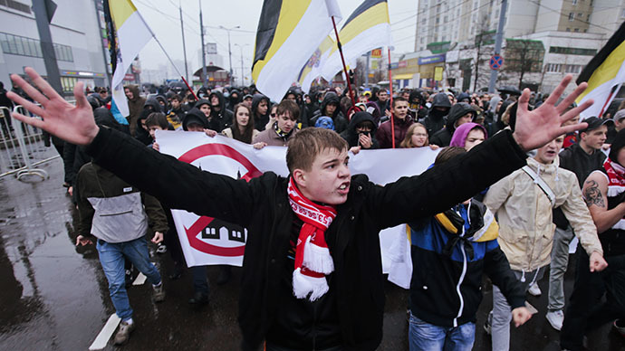 "Russian nationalists hold a banner as they attend a ""Russian March"" demonstration on National Unity Day in Moscow November 4, 2013. (Reuters / Tatyana Makeyeva)"