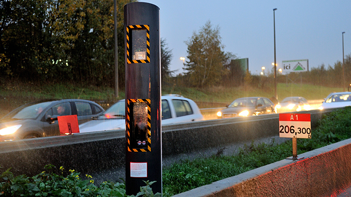 Cars drive past a fixed speed camera on the A1 motorway near Lille, northern France (AFP Photo)