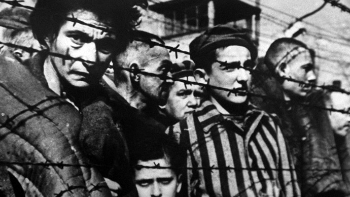 A picture of inmates behind barbed wire taken in 1945 when the concentration camp of Auschwitz was liberated in Poland where millions of Jewish deportees were exterminated by nazis during World War II. (AFP Photo)